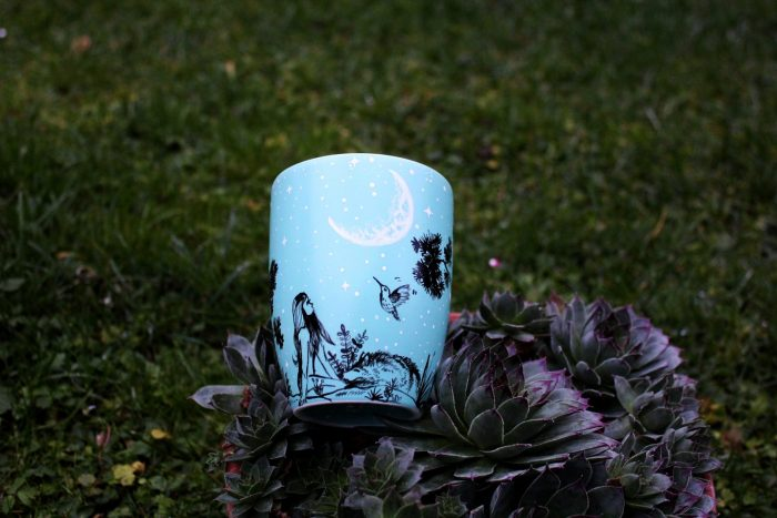 Sleeping wolf mug with girl and humming bird