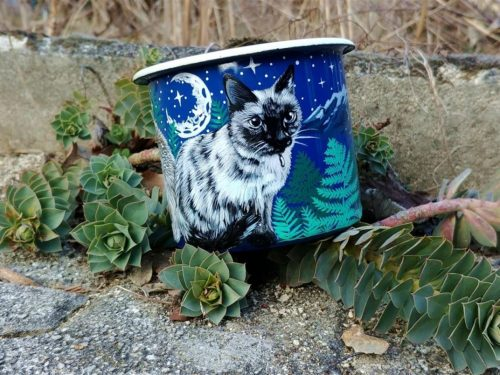 Cats hand painted animals on enamel mugs.