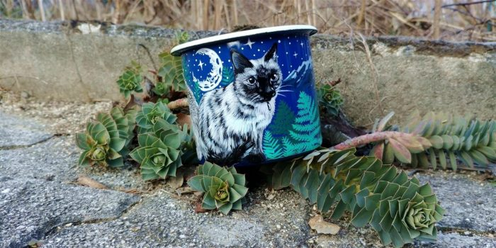 Cats hand painted animals on enamel mugs.